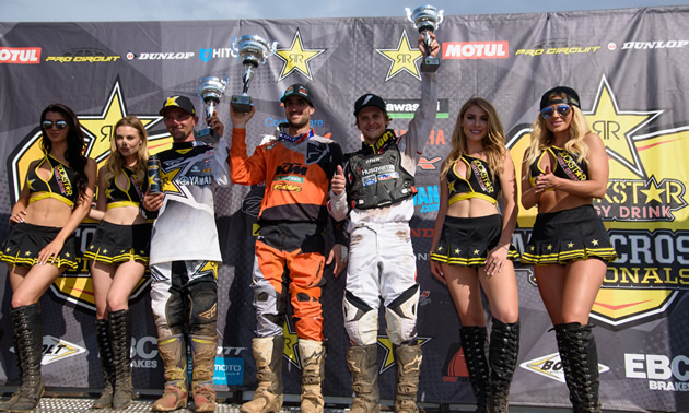 Tyler Medaglia holding his trophy on the podium at Round 7 in Pleasant Valley Raceway.