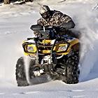 Man on ATV in winter