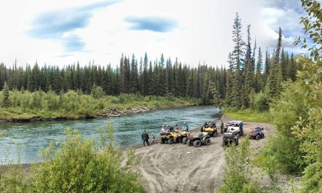 Moose Members take a brake on the edge of the crystal clear waters of the Graham River. North-West of Fort St. John, B.C.