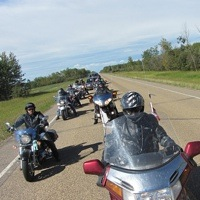 Members of the Mackenzie Highway Motorcycle Association  enjoy a ride on the High Level Circle Tour.