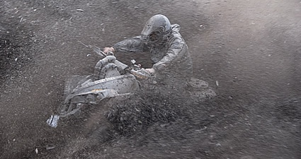 Person riding through mud