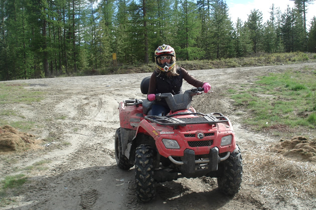 woman quadding in Cranbrook, BC