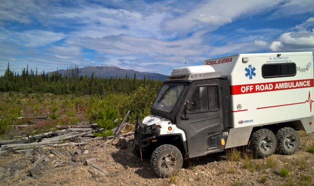 Providing medical services on a remote worksite with a custom off-road ambulance.