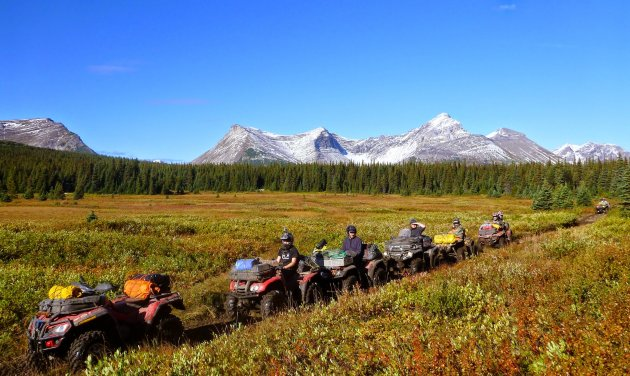The crew from the Moose ATV Club took visitors from Vancouver on a challenging adventure to experience the awesomeness of the spectacular and challenging Onion lake trail. This photo was captured in the beautiful little meadow on the far end of the trail after dropping into the valley from the high alpine. Location: Northern BC, South-East of Tumbler Ridge BC.