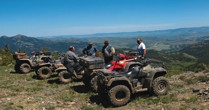 ATVs on a hilltop