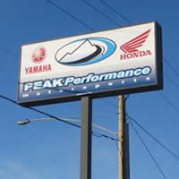 The store sign for Peak Performance Motorsports.