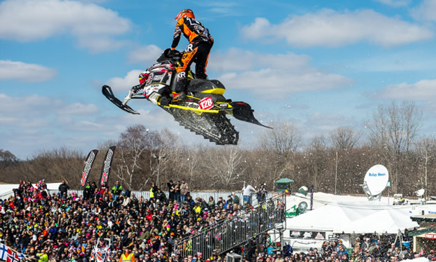 Flying through the air in a snocross race.