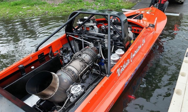 Shown is a General Electric turbine engine in the rear of a red jet boat. The engine is 1600 horsepower.