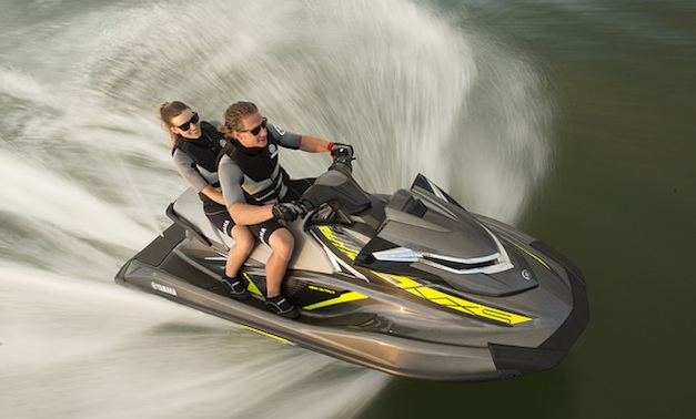 A man and a women on a personal water craft.