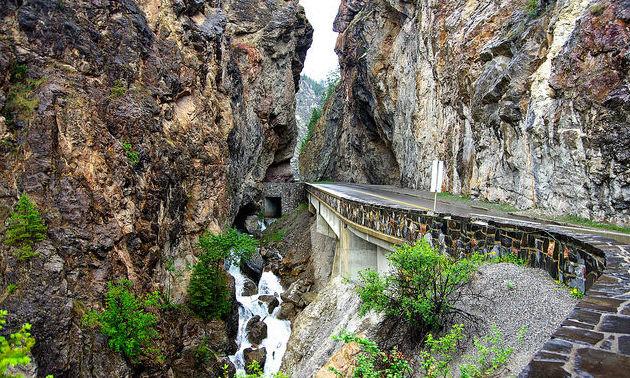 A curved road going through a rock-cut near Radium Hot Springs, B.C.