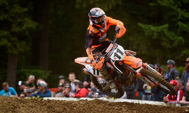 Kaven Benoit gets some air as he round a corner on the motocross track.