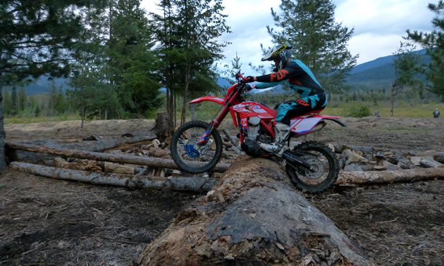 Reagan Sieg tackles the Carl Kuster Mountain Park endurocross track on a red Beta bike.