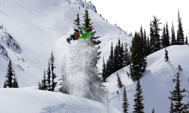 Reagan Sieg taking a huge jump in the mountains with his Timbersled snow bike.