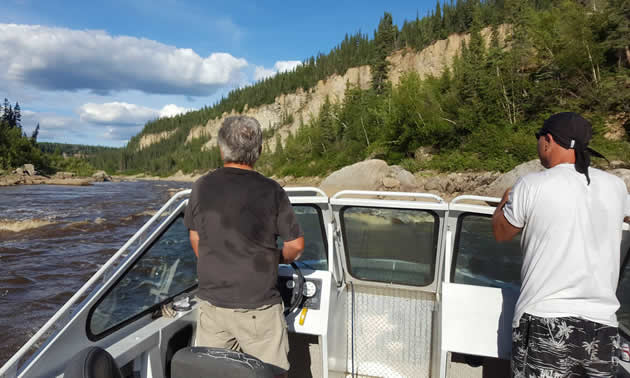 Two men are jet boating on the Hay River.