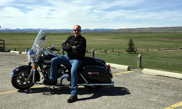 Roger Rhodes taking a break on the Cowboy Trail (Highway 22).