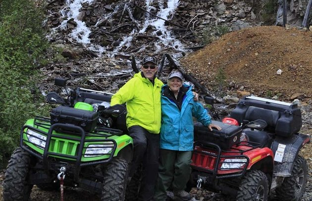 Doug Williamson and Val Traverse with their Arctic Cat TRVs at the Estella Mine.
