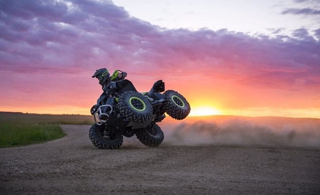 I seen the amazing sky from the setting sun and told my brother to hop on his Renegade. We went out and tried to get a drifting photo. The tires grabbed and he was sent into a bicycle. He recovered and landed on all four wheels, limping away with a sore ankle.