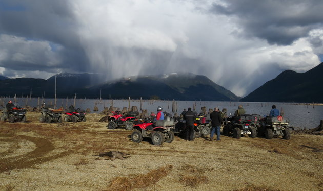 Powell River B.C. ATV Club taking a break at Lois Lake, and overlooking the looming storm.