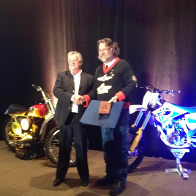 Motorcycles and their riders are lined up for the Manitoba Motorcycle Club's first official run, way back in 1911.