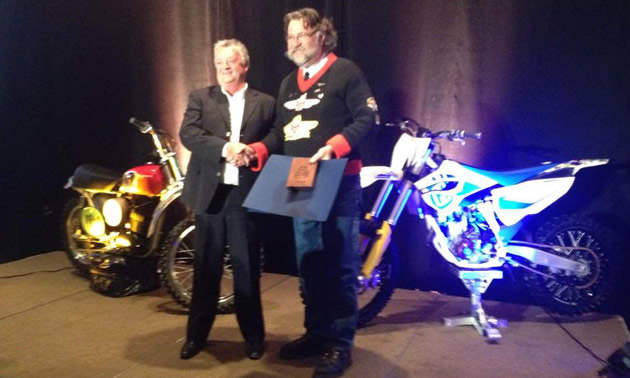 Ross Metcalfe, MMC president, is  receiving the Canadian Motorcycle Hall of Fame 2014 inductee award.