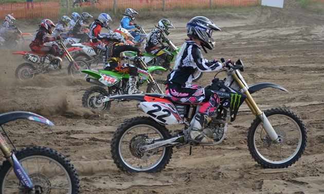 Dirt bike racers coming off the start line.