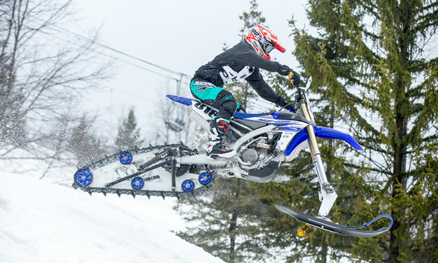 Savage Snowbike jumping.