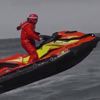A red and yellow search and rescue watercraft.