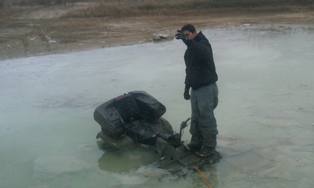 Riding a 2003 Arctic Cat 400, this rider found out how deep it really was - the hard way.