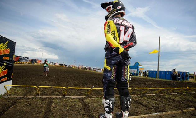 Shawn Maffenbeier stands at the starting gate in Regina, looking at his home track.