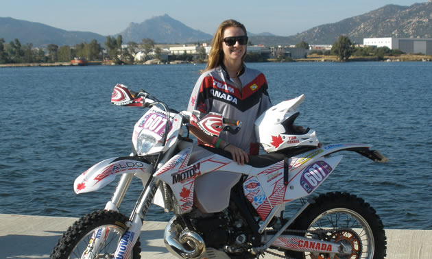 Shelby Turner and her bike in front of a lake in Italy.