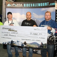 Curtis Pawliuk William Chitty Ron Willert and Murray McKay holding a cheque that snowandmud is presenting to VARDA.