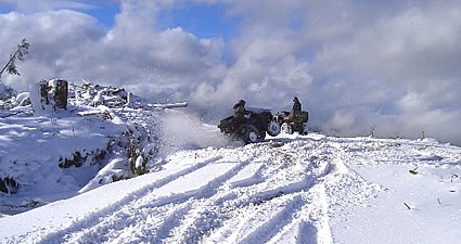 Photo of people ATVing in the winter