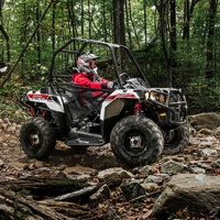 Photo of two Polaris Sprtsman Ace on a backcountry trail.