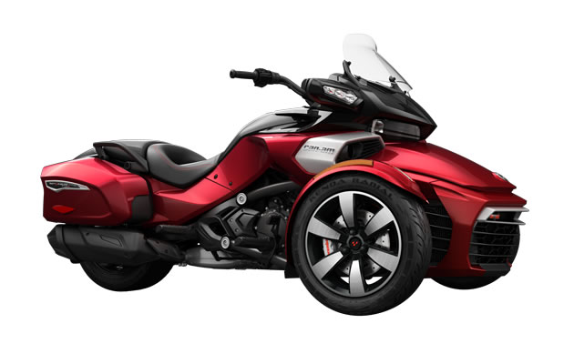 A red Spyder F3 bagger with windshield and built-in saddlebags.