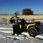 Man standing beside an ATV