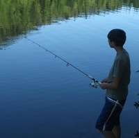 Tatum Evans fishing at a lake.