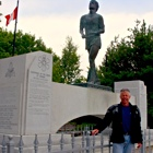 Man in front of terry Fox memorial