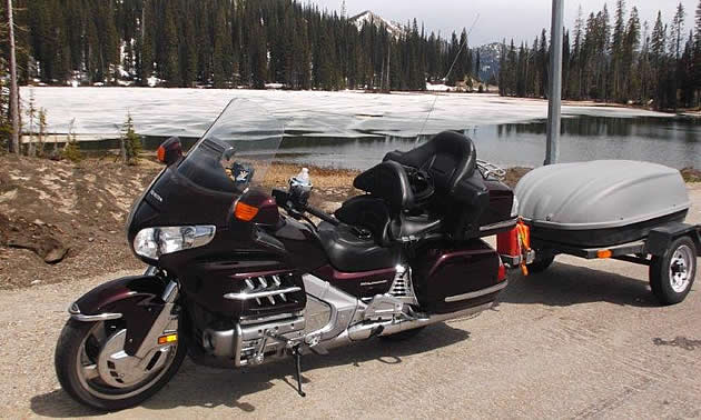 A Honda Goldwing pulling a trailer.