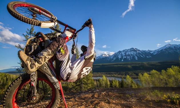 Sam King pulling the ultimate wheelie on his dirt bike.