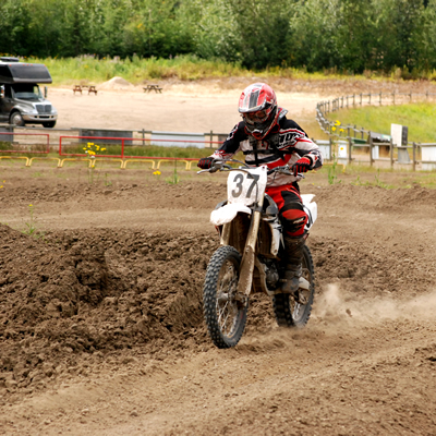 Motocross rider ripping down the track.