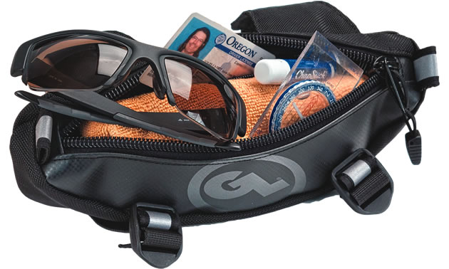 A small black and grey handlebar bag with sunglasses, wallet and driver's licence in it.