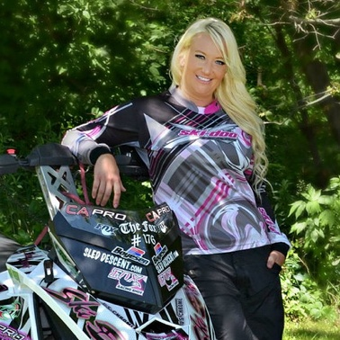 Krista-Maki Zurn, leaning on her snowmobile that she uses for racing in watercross.